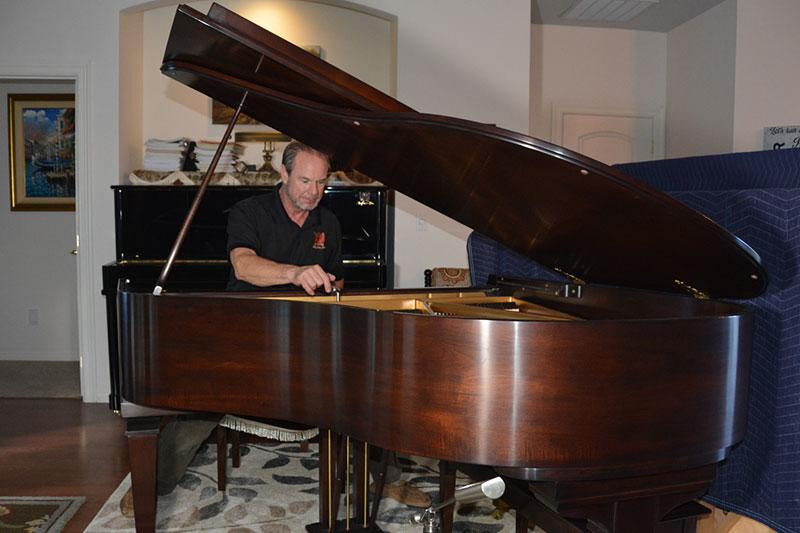 Piano tuner Ira tuning a piano - Piano Tuning