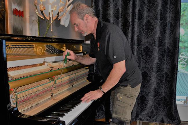 Ira working on a piano - Piano Repair / Restoration